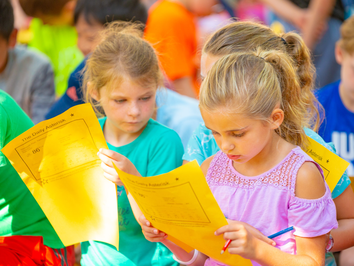 Kids filling out their daily choice activities forms