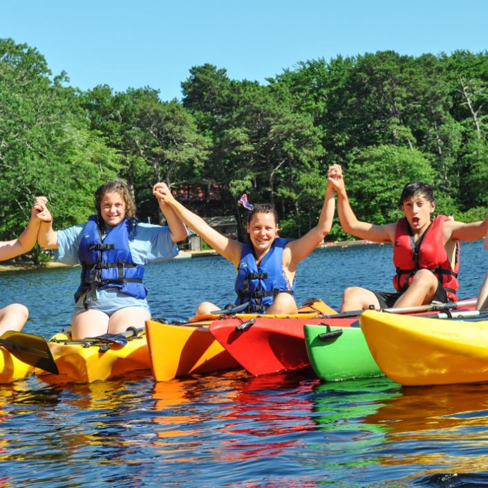 Kids kayaking holding hands