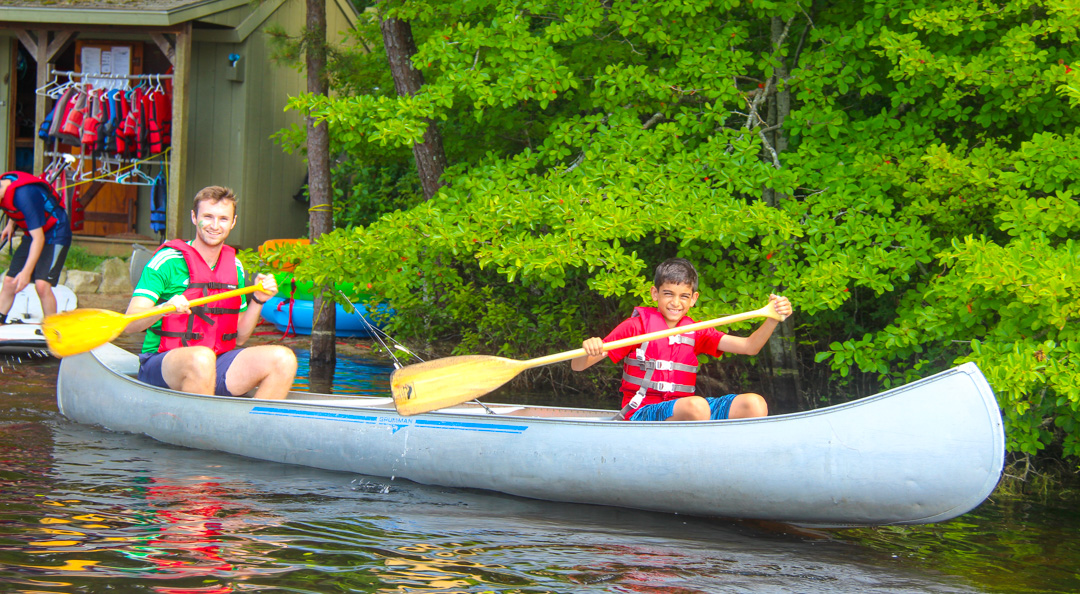 Two boys canoeing