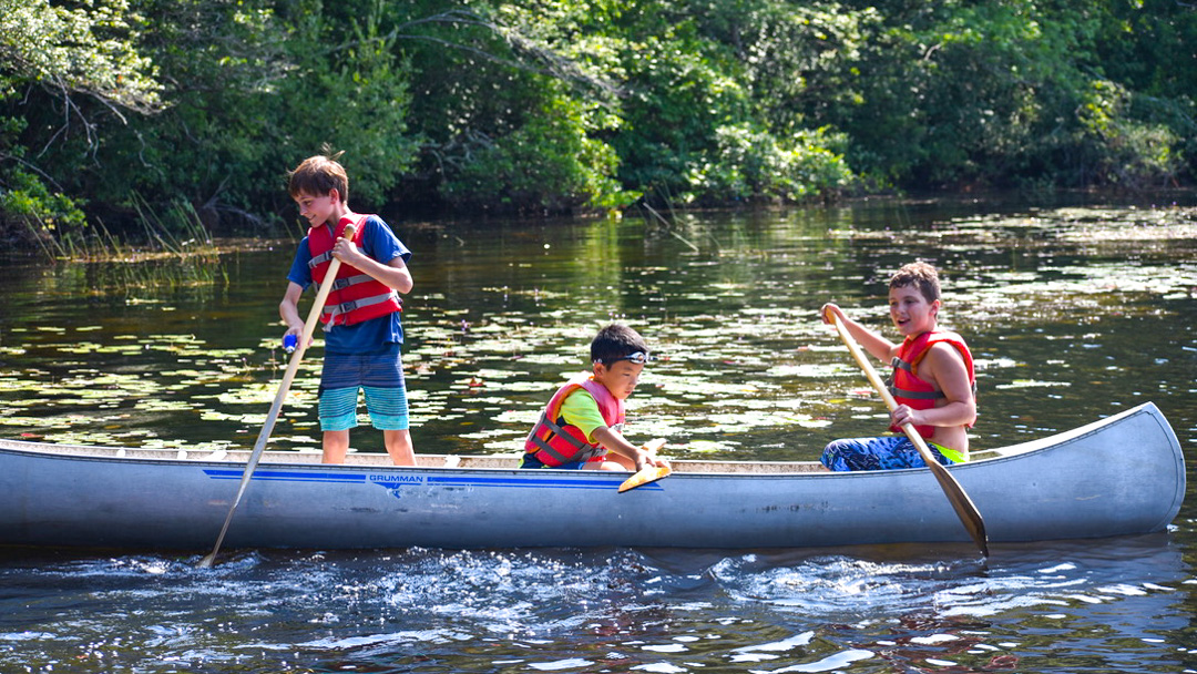 Boys canoeing in the lake