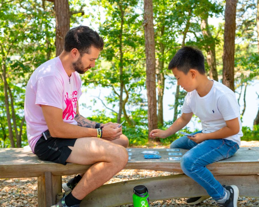 Counselor and camper playing cards