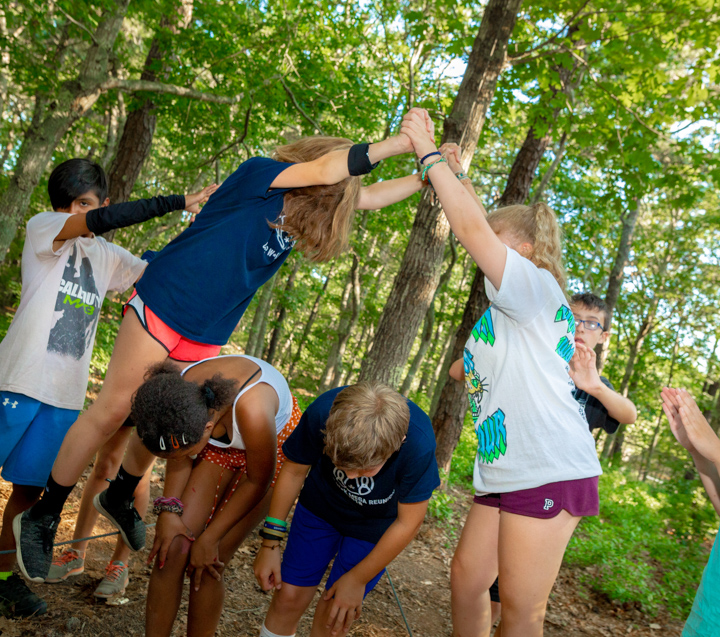 Campers doing a group exercise together
