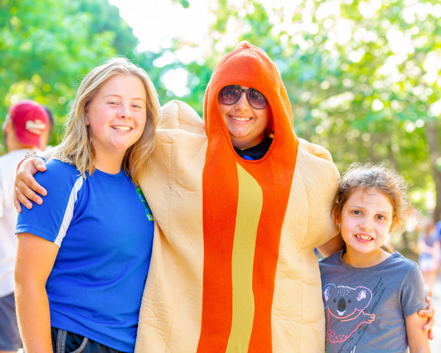 Campers with a counselor dressed in a hot dog costume